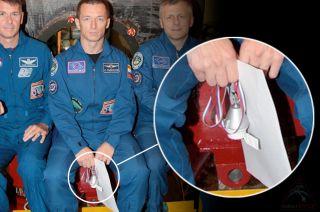 Soyuz MS-02 commander Sergey Ryzhikov and zero-g indicator