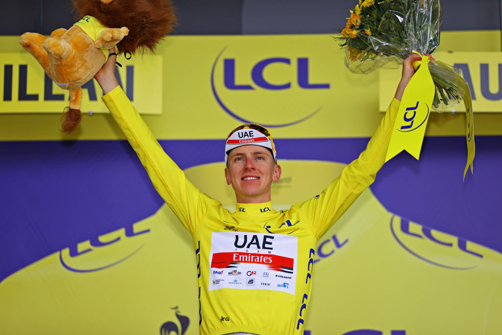 QUILLAN FRANCE JULY 10 Tadej Pogaar of Slovenia and UAETeam Emirates Yellow Leader Jersey celebrates at podium during the 108th Tour de France 2021 Stage 14 a 1837km stage from Carcassonne to Quillan Lion Mascot LeTour TDF2021 on July 10 2021 in Quillan France Photo by Tim de WaeleGetty Images