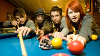 a press shot of paramore playing snooker
