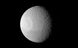 Saturn's Tethys Eyes Cassini