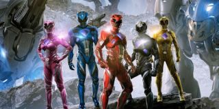 The Power Rangers with the Zords in the background
