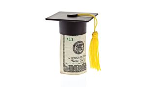 A rolled up 100 dollar bill wears a graduation cap with tassel