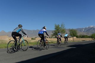 This photograph taken on June 9 2014 shows members of the Afghan national women's cycling team riding their road bikes in Paghman district of Kabul province