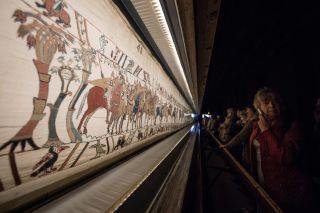 The Bayeux Tapestry tells the story of the Norman conquest of England in 1066.