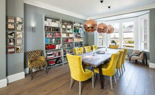 copper pendants over dining room table in renovated period home