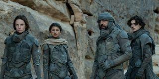 Lady Jessica (Rebecca Ferguson), Chani (Zendaya), Stilgar (Javier Bardem) and Paul Atreides (Timothee Chalamet) stand outside in 'Dune'