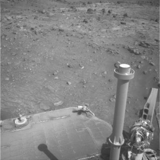 Mars winds blew dust off Spirit's solar array according to data from the rovers power subsystem