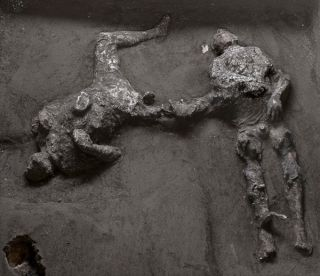 images of bodies of two people buried by pyroclastic flow at Pompeii