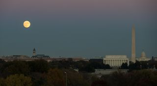 A nearly full supermoon full moon rises over Washington D.C. in this photo by NASA photographer Joel Kowsky captured on Nov. 13, 2016. On Nov. 14, the moon is at its closest to Earth until 2034.