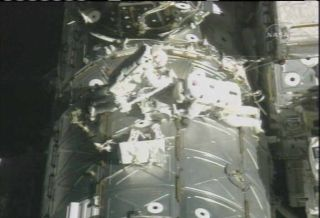 Spacewalkers Test Fire Shuttle Repair Goo Gun
