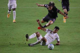 Rodolfo Pizarro of Inter Miami CF tries to avoid the slide tackle by Atlanta United's Miles Robinson on Sept. 9.