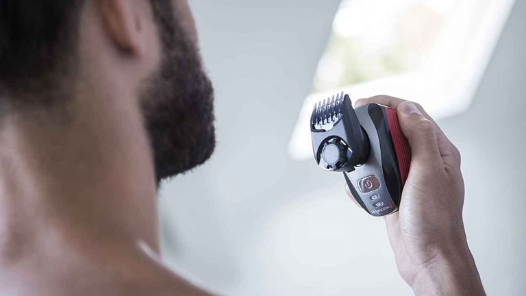 Best electric shaver for bald head: Remington XR1410 Flex360 Rotary Electric Shaver in hand ready for use