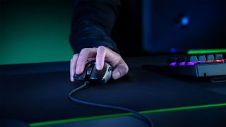 Razer Viper 8K gaming mouse being used on a Razer RGB mousepad