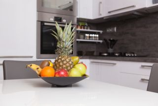 A fruit bowl on a kitchen counter.