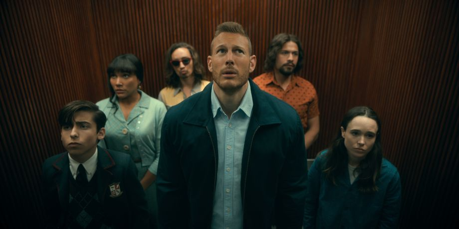 Aiden Gallagher, Emmy Raver-Lampman, Robert Sheehan, Tom Hopper, David Castañeda and Ellen Page gather in a lift in The Umbrella Academy series two