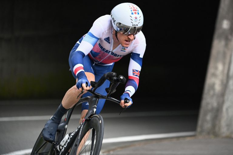 Geraint Thomas riding to 12th place in the Tokyo 2020 Olympic Games individual time trial