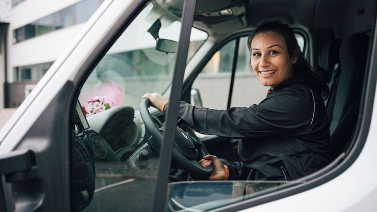 food delivery: woman driving van