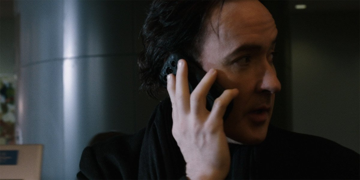 John Cusack talking on the phone in Cell