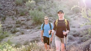 Two hikers hiking in the desert