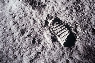 Yes, this is an image of a real footprint on the lunar surface.