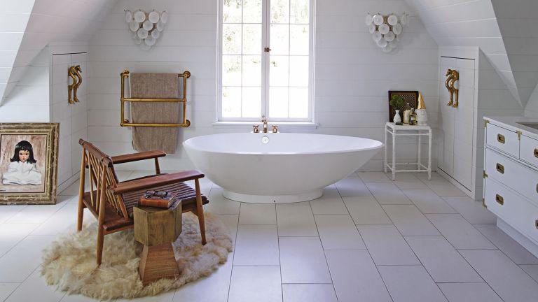 How to hide a radiator White bathroom with sleek freestanding bath tub