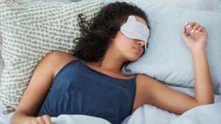 Woman asleep with sleep mask on