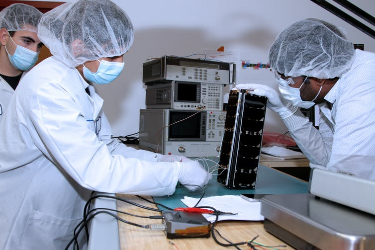 The ever-shrinking size of technology has led to tiny satellites like the one students are working on here.
