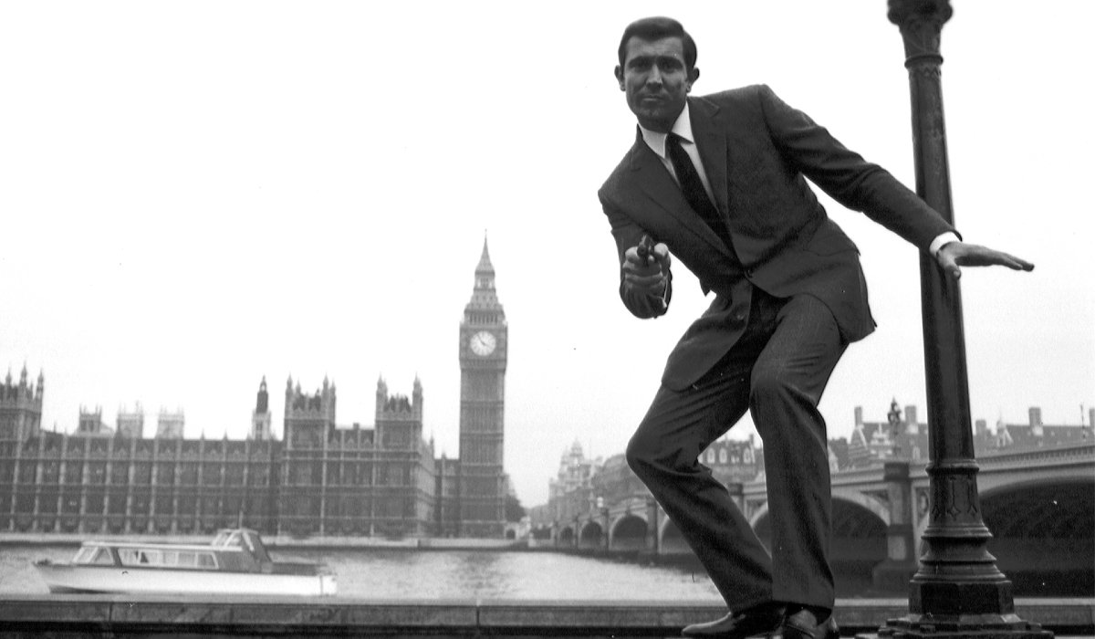 On Her Majesty's Secret Service George Lazenby takes aim outside of Parliament