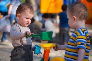babies playing at playground