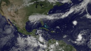 Four tropical storms and hurricanes in satellite image.