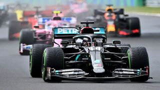 F1 British driver Lewis Hamilton leads other racers at start of Grand Prix in Hungary