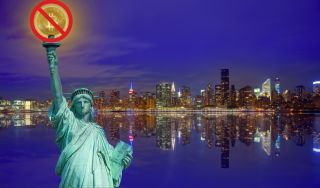 """Bitcoin on the Statue of Liberty, covered by a """"no"""" symbol."""