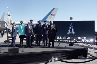 Vice President Mike Pence, joined by leaders of the U.S. Air Force and U.S. Space Force, helps reveal signs bearing the redesignated names of Cape Canaveral Space Force Station and Patrick Space Force Base in Florida on Wednesday, Dec. 9, 2020.