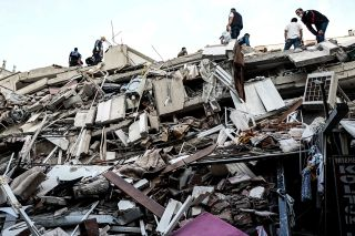 A powerful earthquake strikes near Turkey's city of Izmir, collapsing buildings and killing at least 14 people. Search and rescue efforts are underway to look for survivors in the rubble.