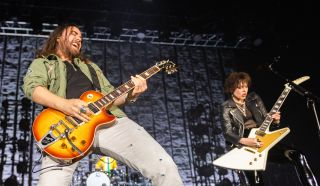 Joe Hottinger (left) and Lzzy Hale of Halestorm perform on stage at The SSE Hydro on November 24, 2019 in Glasgow, Scotland