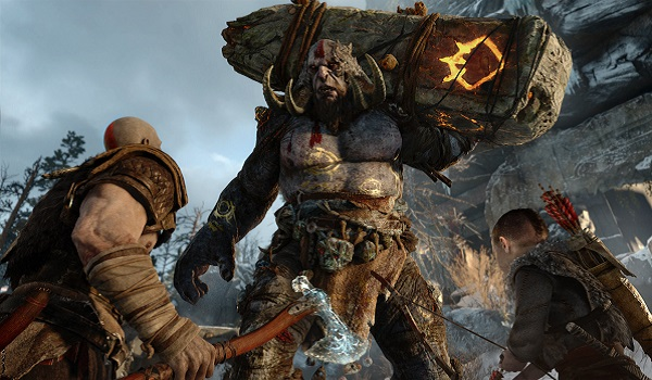 Kratos and son fight a troll in god of war