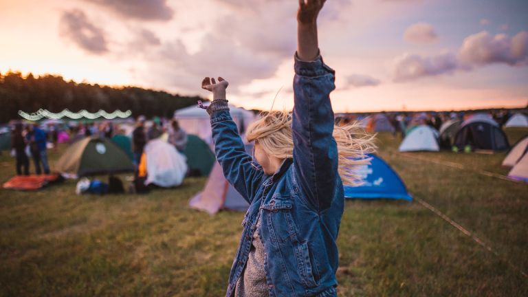 best festival tents: woman dancing at a festival