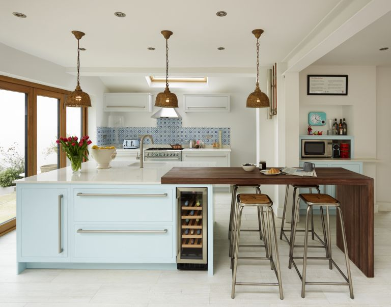 kitchen island with feature lighting from Harvey Jones