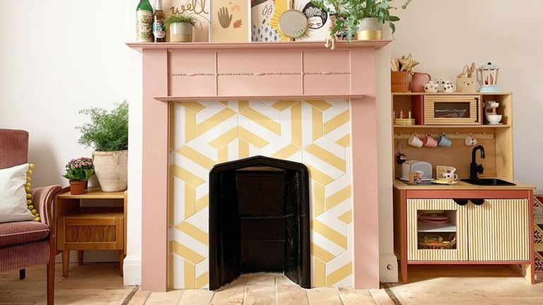 Fireplace tile ideas in living room with pink paint decor and Neopolitan Yellow Porcelain Tile by Ca'Pietra