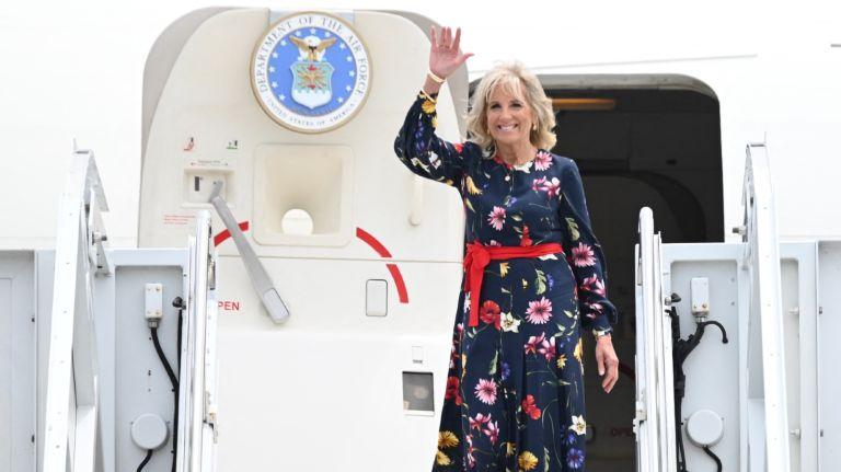 US First Lady Jill Biden waves as she walks off the plane as she arrives in Savannah, Georgia on July 8, 2021.