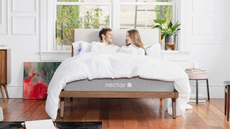 Nectar mattress discount code: on bed with man and woman