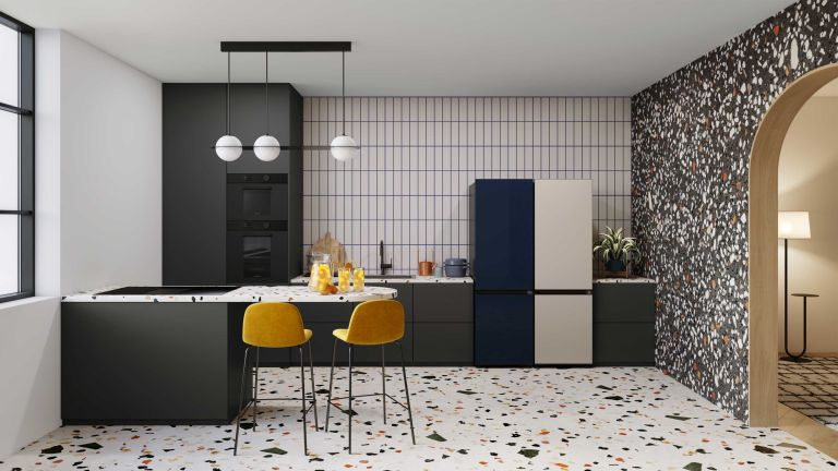 samsung glam navy fridge in a midcentury modern kitchen with terazzo tiles and statement lighting