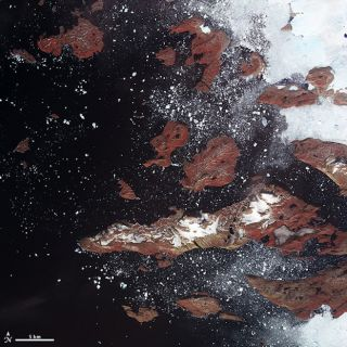 Icebergs that have broken off from tidewater glaciers on the coast of Greenland as seen by NASA's Terra satellite