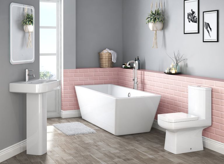 bathroom suite with angular lines, pink metro tiles and grey walls