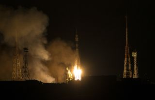 A Russian Soyuz rocket and TMA-15M spacecraft blast off from Baikonur Cosmodrome, Kazakhstan on a mission to ferry a new crew to the International Space Station on Nov. 23, 2014. Riding the rocket into orbit were NASA astronaut Terry Virts, European Space