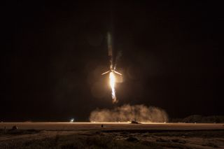 A SpaceX Falcon 9 rocket descends toward Landing Pad 1 at the Cape Canaveral Air Force Station in Florida during a successful landing on Dec. 21, 2015 after delivering 11 ORBCOMM satellites into orbit.