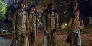 The Stranger Things boys in Ghostbusters costumes
