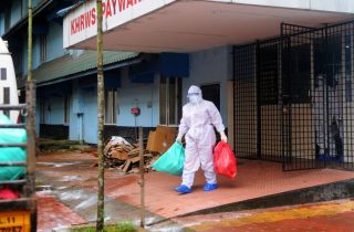 A health official stands outside the Kozhikode Medical College Hospital ward, which has been converted into a Nipah virus isolation ward on September 06, 2021 in Kozhikode, India.