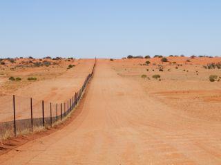 The dingo fence in Strzelecki Desert.