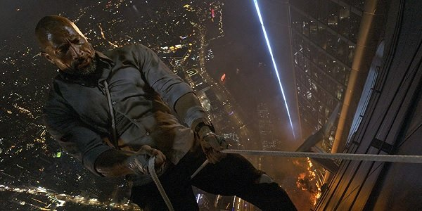 Skyscraper Dwayne Johnson rapelling from a flaming building